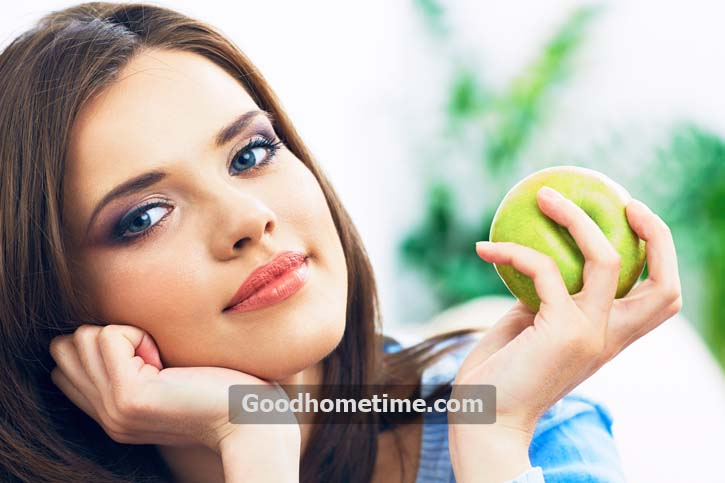 351.2. young-woman-hold-green-apple