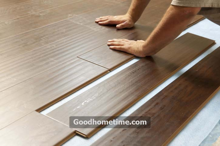 take out the planks from the boxes and first place one of them on top the adhesive and press down gently